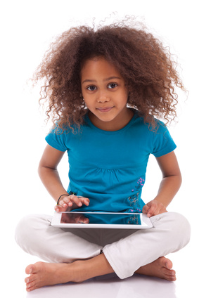 Little african asian girl using a tablet  pc, isolated on white background